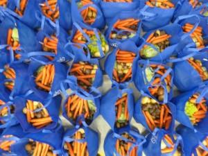 Bags full of fresh produce for family